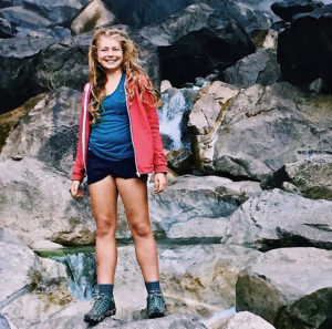 Holly Levett standing in front of rocks